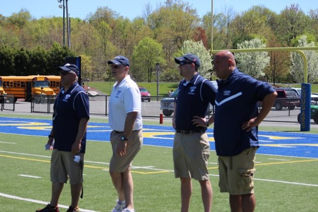 Dr. Cella (near) coaching at the 2013 Lackawanna College Spring game with Charlie Grande (far left), Head Coach Mark Duda (2nd from left), and Josh Pardini (next to Dr. Cella).
